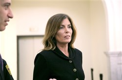 Pennsylvania Attorney General Kathleen Kane, who was convicted Monday of perjury and other crimes, leaves the courtroom.