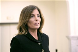 Former Pennsylvania Attorney General Kathleen Kane leaves the courtroom after closing arguments in her perjury and obstruction trial.