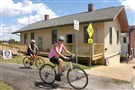 John and Regina Meutris of Steubenville, Ohio, finish their 32-mile bike ride in front of the rebuilt train station on Main Street in Burgettstown.