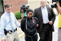 Adriene Williams, 27, is taken into court last week.