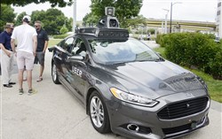 A Ford Fusion on display in July at Point State Park was outfitted at Uber's Advance Technologies Center in the Strip District.