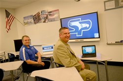 South Park Middle School principal Kevin Monaghan and superintendent Wayne Gdovic sit in a newly renovated classroom at the school.