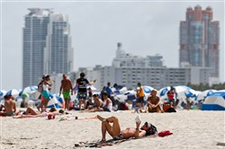 Beachgoers along the shore in South Miami Beach. A cluster of Zika cases most likely transmitted by local mosquitoes has been identified in Miami Beach, a health official said on Aug. 18. Health authorities are trying to decide whether to designate a section of the bustling tourist city as a zone of active Zika transmission, and whether to advise pregnant women to avoid the area