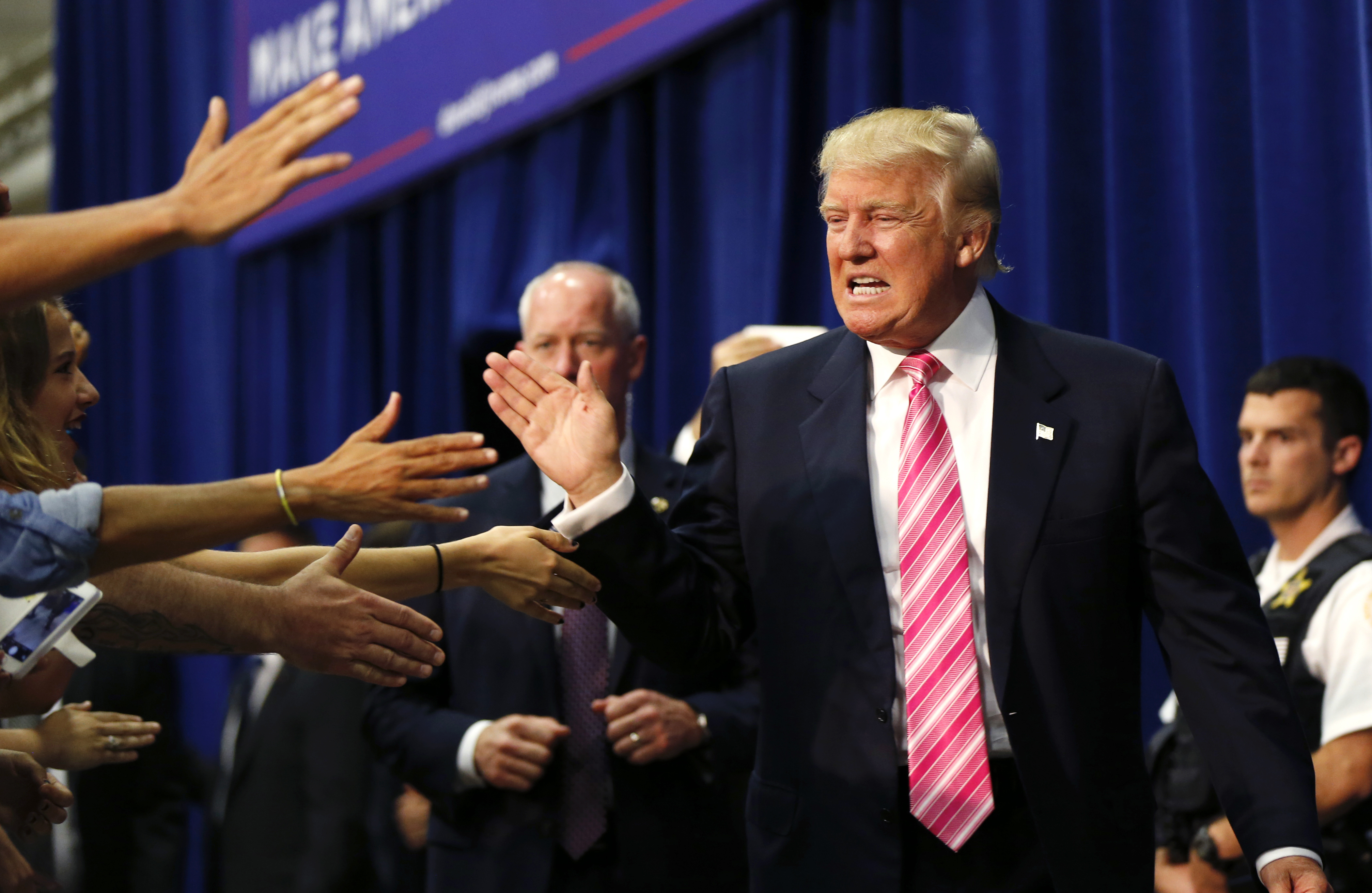 NationWorld41-1 Republican presidential candidate Donald Trump greets the crowd as he arrives to speak at a campaign rally in Fredericksburg, Va., earlier this month.