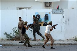 Forces loyal to Libya's U.N.-backed Government of National Accord hold a position near the central area known as District One on Sunday as they fight against the Islamic State radicals holed up in the coastal city of Sirte, east of the capital Tripoli.