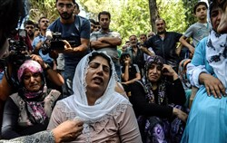 Women cry during a funeral Sunday for a victim the attack on a wedding party that left at least 51 dead in Gaziantep, Turkey.