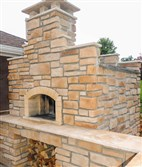 A wood-fired stone oven constructed by Aldo Betta is a highlight of his back yard.