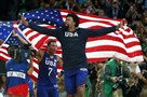 DeAndre Jordan, center, and Kyle Lowry of the U.S. celebrate with American flags after the men's basketball gold medal game against Serbia Sunday at in Rio de Janeiro. The U.S. team won, 96-66, to take the gold medal.