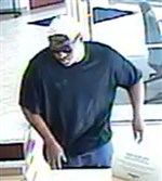 Surveillance footage shows the man suspected of robbing a Dollar Bank at the Crafton/Ingram Shopping Center on Monday.