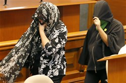 "Witnesses cover their faces as they arrive to testify before the Philippine Senate, which is probing the extrajudicial killings related to President Rodrigo Duterte's ""War on Drugs"" on Monday in suburban Pasay city, south of Manila/"