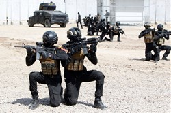 "Members of the ""Golden Division,"" the special unit of the Iraqi counterterrorism forces, take part in training under the command of international military instructors in Baghdad on March 20 as they prepare for a future operation aimed at retaking the northern city of Mosul, which is the Islamic State group's last major stronghold in the country."
