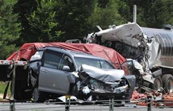 This June 11, 2013 file photo shows a minivan and two semitrailers that were involved in fatal crash in Shorter, Ala.