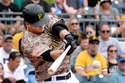 Pirates' David Freese hits an RBI single in the first inning against the San Diegot Padres Thursday afternoon at PNC Park.