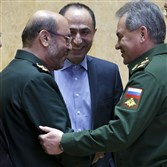 In this Feb. 16 file photo, Russian Defense Minister Sergei Shoigu, right, and Iranian Defense Minister Gen. Hossein Dehghan shake hands during their meeting in Moscow.