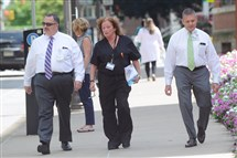 From Left, Patrick Boyle, Cassie Dettorre and Scott Croonquist walk around West Penn Hospital along Friendship Avenue in Bloomfield during their lunch break.
