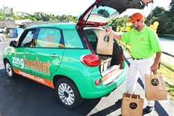 A new grocery delivery service in Pittsburgh called Zing Basket.. Shown here, Alex Pachis delivery driver.