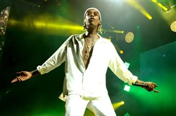 "Wiz Khalifa performs during his ""The High Road Tour"" at the BB&T Pavilion in Camden, N.J., on Aug. 5. A lawyer representing 17 people injured when a railing collapsed at the Aug. 5, concert is suing the performers and the venue's owner."