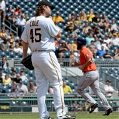 The Astros' Evan Gattis rounds the bases after hitting a two-run home run against the Pirates' Gerrit Cole in the second inning Wednesday at PNC Park.
