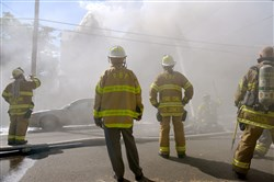 Firefighters work to control a fire Wednesday on Lytle Street in Hazelwood.