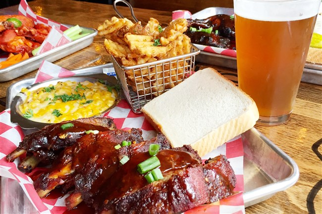 A platter of ribs with Kansas City cheesey corn at Twelve Whiskey Barbecue on the South Side.