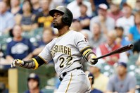 Andrew McCutchen hits a solo home run in the first inning Thursday at Miller Park.