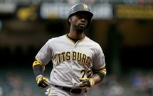 Andrew McCutchen rounds the bases after hitting a home run in the first inning Thursday at Miller Park.