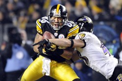 The Steelers' Hines Ward pulls in a pass as he's defended by the Ravens' Haruki Nakamura in the fourth quarter at Heinz Field in 2011. Nakamura took a career-ending hit to the side of his head while making a tackle while playing for the Carolina Panthers in a 2013 preseason football game against the Steelers.