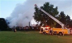 Firefighters battle a blaze at a home in West Deer this morning.
