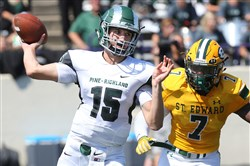 Pine-Richland quarterback Phil Jurkovec drops back to pass in the Rams' season opener at St. Edward's (Ohio) last month.