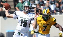Pine-Richland quarterback Philip Jurkovec prepares to throw a pass pressured by St. Edward of Ohio linebacker Antonio Hills on Saturday in Lakewood, Ohio.