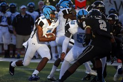 Saeed Holt #3 of the Woodland Hills Wolverines carries the ball against the Gateway Gators.