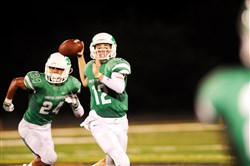 South Fayette quarterback Drew Saxton throws a pass against Central Valley Friday at South Fayette High School.