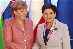 German Chancellor Angela Merkel,left, is greeted Friday by Poland's Prime Minister Beata Szydlo in Warsaw, Poland, as she arrives for talks with four central European leaders about the shape of the European Union after Britain leaves.