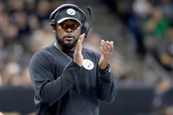 Steelers head coach Mike Tomlin claps as his team prepares to take on the Saints Aug. 26 at the Mercedes-Benz Superdome in New Orleans.