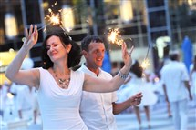Dancing with sparklers at Diner en Blanc at PPG Place on Saturday, August 27, 2016.