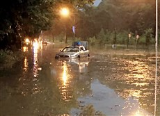 A car sits partially submerged Aug. 28 on Washington Boulevard in Pittsburgh's East End neighborhood.