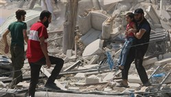 A Syrian man carries a girl away Saturday from the rubble of a destroyed building after barrel bombs were dropped on the Bab al-Nairab neighborhood in Aleppo, Syria.