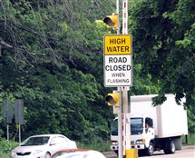 The floodgate located at the intersection of Washington Boulevard and Allegheny River Boulevard, shown here in May 2012, is one of three floodgates and five advanced warning signs around Washington Boulevard installed to warn motorists and pedestrians of flash flooding. It was inoperable Sunday during heavy storms which eventually flooded the area.