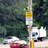 The floodgate located at the intersection of Washington Boulevard and Allegheny River Boulevard is one of three floodgates and five advanced warning signs around Washington Boulevard installed to warn motorists and pedestrians of flash flooding.