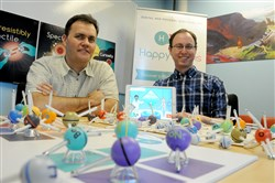 CEO Jesse Schell, left, and advanced game designer Yotam Haimberg seen here in 2016 launching Happy Atoms, an educational tool that incorporates both physical and digital elements.