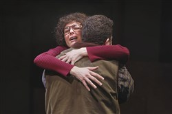 "Molly Rush, portrayed by Nancy Bell, hugs her husband, Bill, played by Joe Osheroff, in the Repertory Theatre of St. Louis production of Tammy Ryan's ""Molly's Hammer"" last March. A professional reading by different actors of the play about the Pittsburgh activist will take place Friday at Chatham University in a benefit for the Thomas Merton Center."