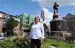 Nancy Noszka, the former head of the Lawrenceville Development Corp., stands near the intersection of Penn Avenue and Butler Street in Lawrenceville.