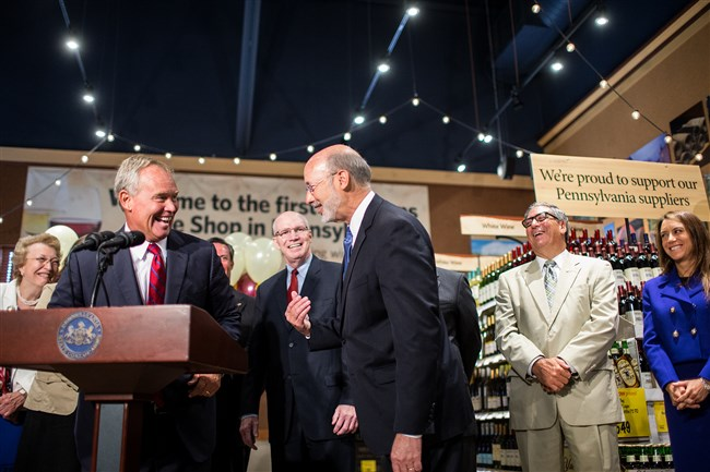 Mike Turzai, left, the state Speaker of the House, and Gov. Tom Wolf joke around during a press conference Thursday to introduce the sale of wine at Wegmans in Mechanicsburg, Pa.
