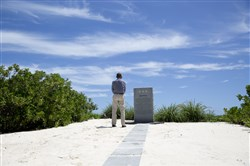 President Barack Obama pauses at the Battle of Midway Navy Memorial as he tours on Midway Atoll in the Papahanaumokuakea Marine National Monument, Northwestern Hawaiian Islands, on Thursday.