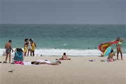 People enjoy themselves on the beach on the day that Florida state officials announced they found the Zika virus in trapped mosquitoes in the city, the first time this has happened in the continental US on September 1 in Miami Beach, Florida.