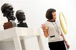 Carnegie Art Museum volunteer docent Barbara Carney talks about Auguste Rodin's sculptures during a tour on Friday.
