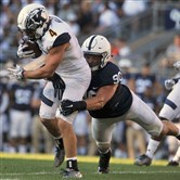 Penn State's Garrett Sickels tackles Kent State's Nick Holley at Beaver Stadium on Sept. 3. Penn State won 33-13.