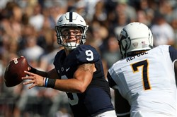 Penn State quarterback Trace McSorley  drops back to pass against Kent State during the first half of Saturday's game in State College.