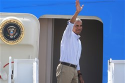 President Barack Obama waves to spectators as he departs fFriday in Honolulu for China.