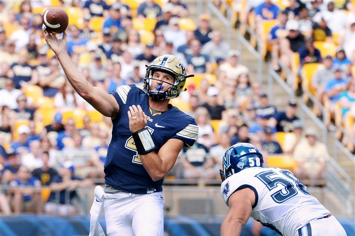 20160903mfpittsports23-3 Pitt quarterback Nathan Peterman gets a throw off in front of Villanova's Jeff Steeb in the first quarter of the season opener last year at Heinz Field.